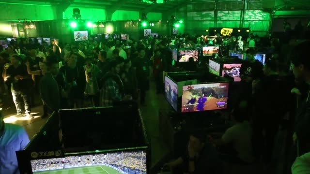 Xbox One Launch Event in Los Angeles California Wideshots of packed convention center filled with Xbox One Demo stations Gamers testing various Xbox...