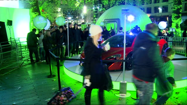 Xbox One Launch **Music heard intermittently SOT** People along / woman dressed as zombie / red supercar People playing games / Xbox One console EXT...