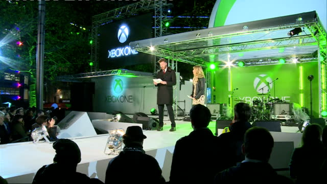 xbox one launch rick edwards and sian welby on stage / people in crowd - xbox stock videos & royalty-free footage
