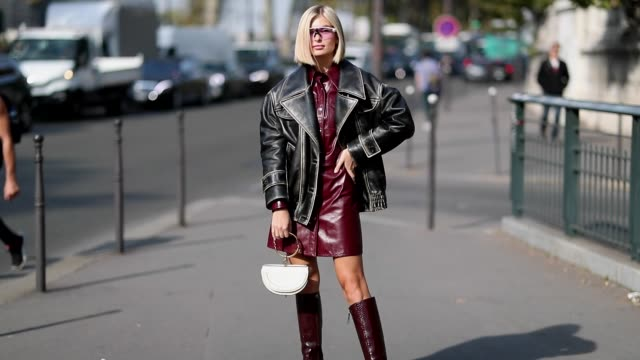 xenia adonts wearing black leather jacket bordeaux vinyl dress boots white chloe bag is seen outside balmain during paris fashion week womenswear... - leather jacket stock videos & royalty-free footage