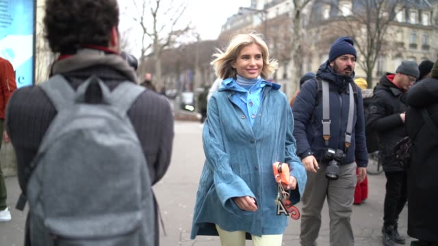xenia adonts wears a blue jacket, a turtleneck, yellow flare pants, outside acne, during paris fashion week - menswear f/w 2019-2020, on january 20,... - jacket stock videos & royalty-free footage