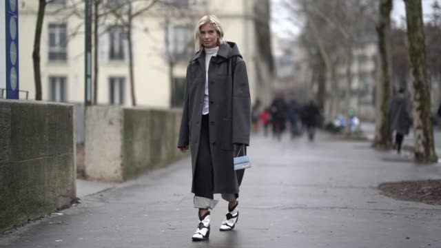 vídeos de stock, filmes e b-roll de xenia adonts wears a gray coat outside jacquemus during paris fashion week menswear f/w 20192020 on january 20 2019 in paris france - xenia van der woodsen