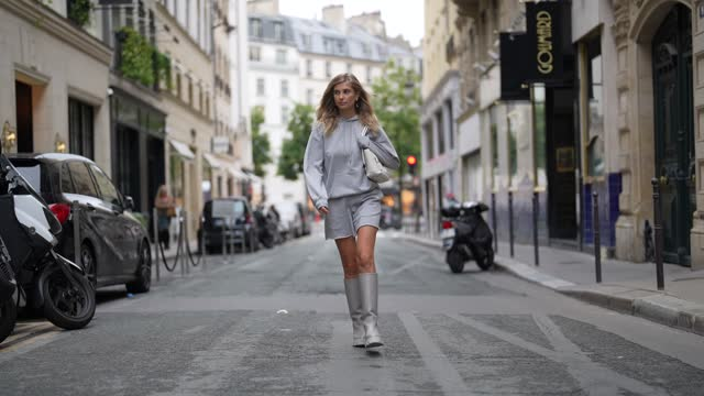 xenia adonts wears a pale gray hoodie oversized sport sweater from celine, pale gray matching sport shorts from celine, a white matte leather handbag... - long hair stock videos & royalty-free footage
