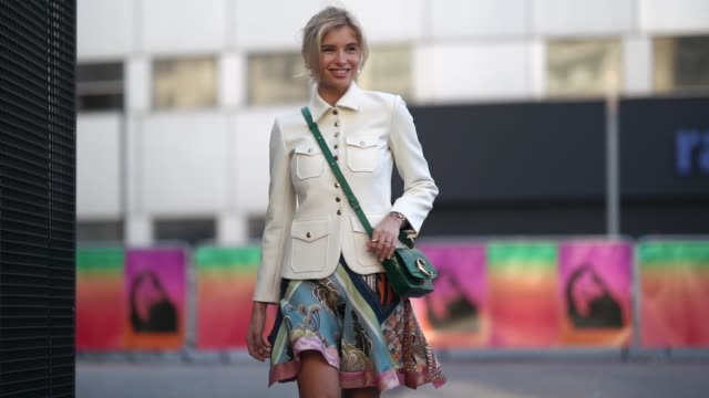 xenia adonts wears a white jacket, a green chloe bag, a multicolor floral print skirt, sneakers shoes, outside chloe, during paris fashion week... - street style stock videos & royalty-free footage