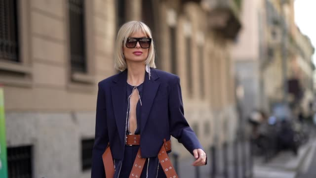xenia adonts wears sunglasses, a navy blue jacket, a brown large leather belt, shorts, bejeweled shiny bejeweled pointy shoes, outside sportmax,... - navy blue stock videos & royalty-free footage