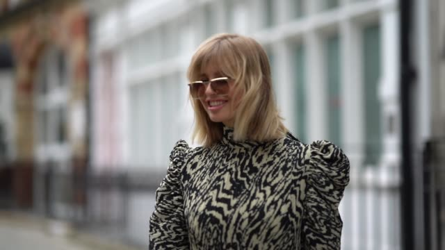 xenia adonts wears sunglasses a zebra print pattern dress with padded shoulders a black bag black leather boots during london fashion week september... - zebra print stock videos & royalty-free footage