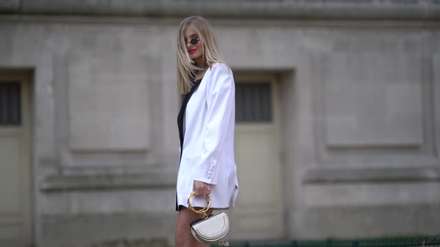 xenia van der woodsen 'overdose' wears a white oversized blazer jacket dress, sunglasses, a double black and white chloe bag, black boots, during... - street style stock videos & royalty-free footage