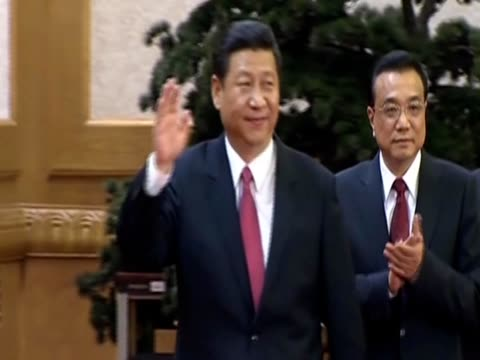 xi jinping and his team wave at journalists after being chosen by the 18th communist party congress to be china's next leaders - communist party stock videos and b-roll footage