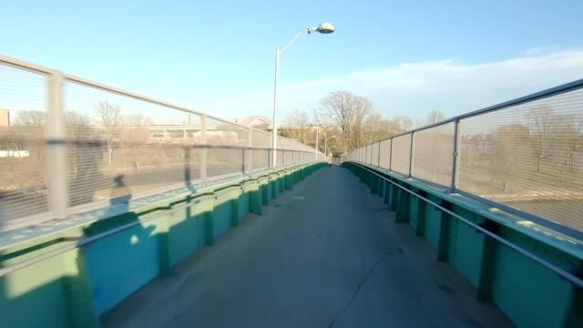 pov xi queens new york city front bridge sunset winter - marciapiede video stock e b–roll