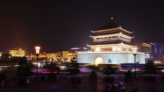 xi'an ancient chinese towers surrounded by traffic - forbidden city stock videos & royalty-free footage