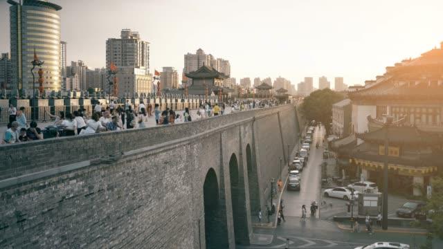xian city wall at sunset ,xian, shaanxi, china - surrounding wall stock videos & royalty-free footage