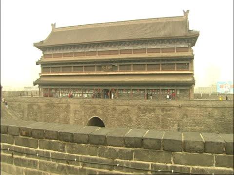 wa xian first gate, tourists walking around, xian, china - antike kultur stock-videos und b-roll-filmmaterial