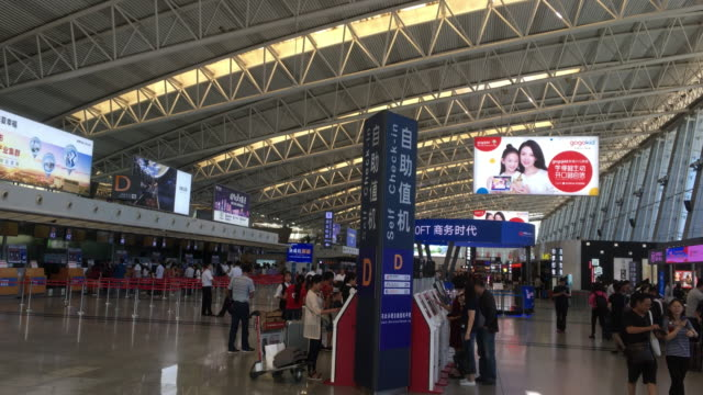 xi'an xianyang international airport located at 25 kilometers northwest of xi'an city is one of the eight major regional airports in china - biglietto aereo video stock e b–roll