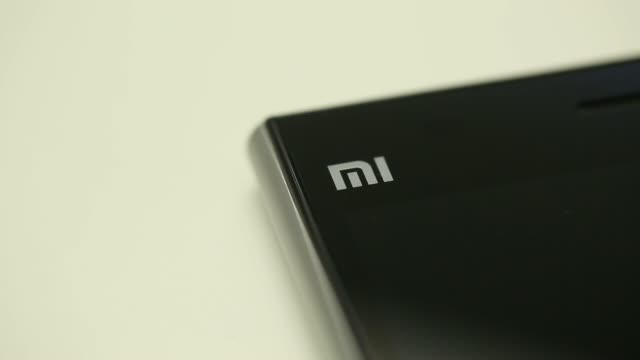 a xiaomi corp redmi smartphone running google incs android operation system is arranged for a photograph in hong kong china on wednesday april 30 the... - logo stock-videos und b-roll-filmmaterial