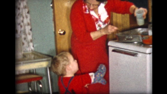 1957 Xmas dinner with family, boy helps