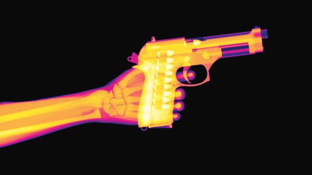 x-ray of a hand raising a pistol and firing - pistolenschießen stock-videos und b-roll-filmmaterial