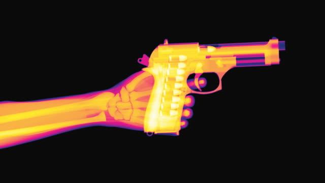 x-ray of a hand raising a pistol and firing - handgun stock videos & royalty-free footage