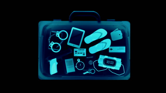 x-ray scan detects weapon in criminals briefcase - security stock videos & royalty-free footage