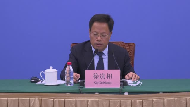 xu guixiang, spokesperson of the xinjiang uygur autonomous region government, speaks at a press conference on xinjiang-related issues on august 12 in... - human arm stock videos & royalty-free footage