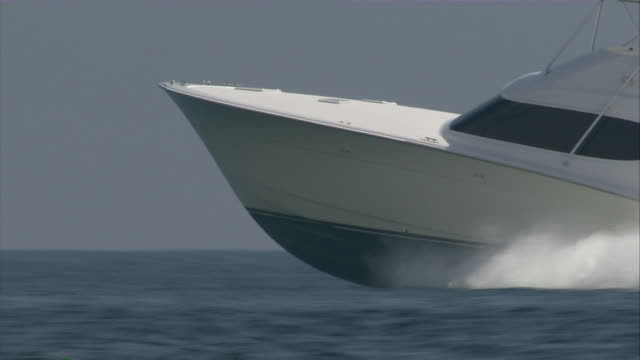 ms yacht breaching through ocean waves / miami, florida, usa - millionär stock-videos und b-roll-filmmaterial