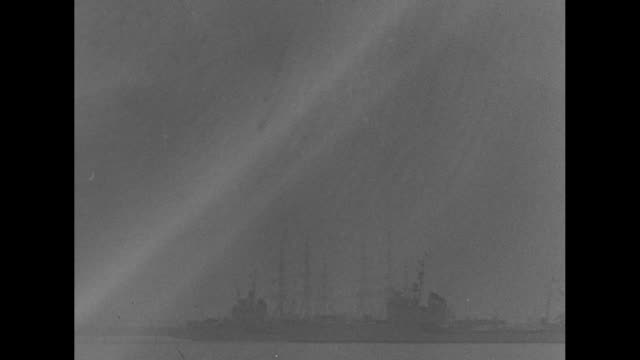 stockvideo's en b-roll-footage met ws yacht carrying german chancellor adolf hitler italy's king victor emmanuel iii and prince humbert cruises thru fog past docked italian naval fleet... - koninklijk persoon