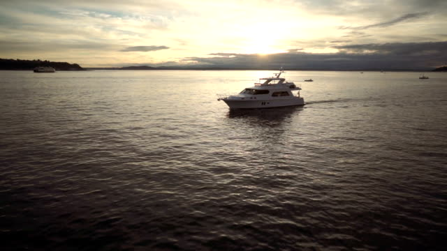 yacht in harbor at sunset - grattacielo video stock e b–roll