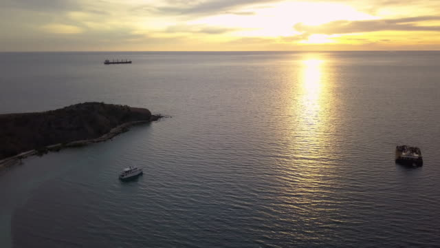 yacht in port moresby, papua new guinea at sunset - bay of water stock videos & royalty-free footage