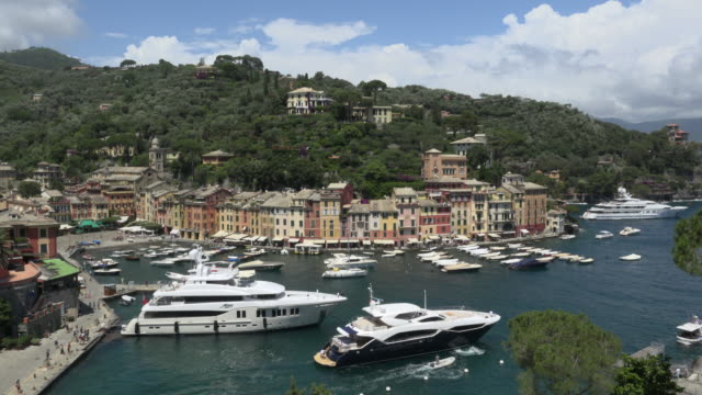 yacht leaves marina of portofino - jachthafen stock-videos und b-roll-filmmaterial