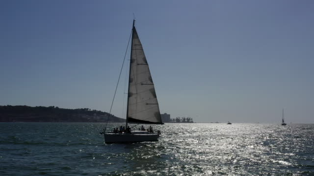 yacht on tagus river / lisbon, portugal - floating on water stock videos & royalty-free footage