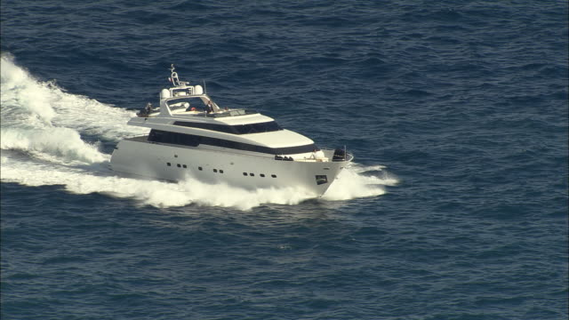 stockvideo's en b-roll-footage met aerial yacht on the mediterranean/ cote d'azur, france - jachtvaren