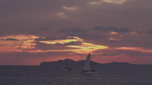 yacht on the sea at sunset / jeju-do, south korea - romantic sky stock videos & royalty-free footage