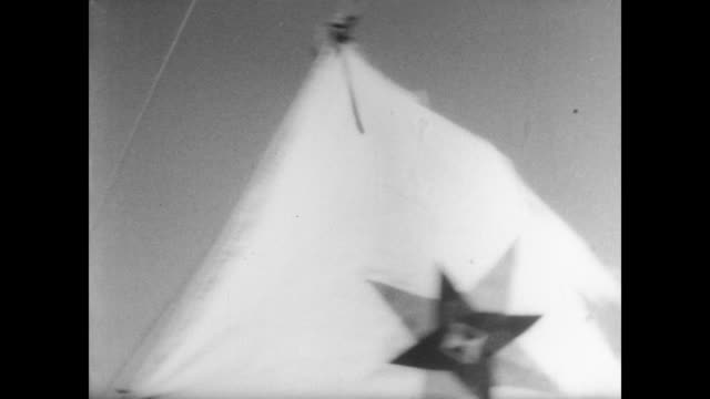 yacht 'phoenix' sails from japan carrying quaker pacifists to haiphong port in north vietnam / cu writing on yacht 'phoenix of hiroshima honolulu' as... - 1967年点の映像素材/bロール