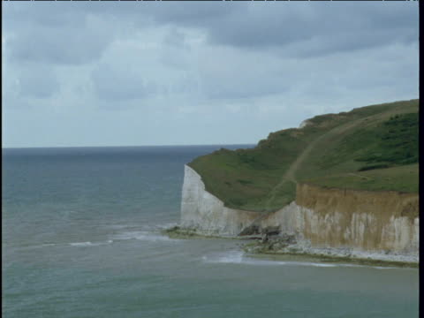 yacht sails past as tide slowly recedes seven sisters east sussex - english channel stock videos and b-roll footage