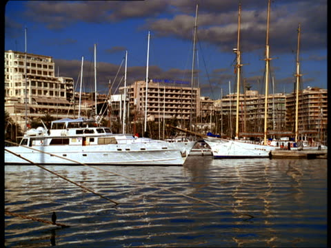 a yacht sails through a marina. - balearic islands stock videos and b-roll footage
