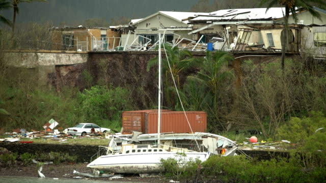 yacht washed ashore by storm surge and strong winds in aftermath of cyclone debbie in australia - coastal feature stock videos & royalty-free footage