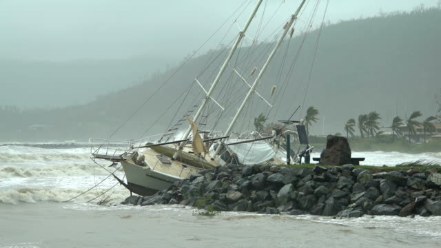 A yacht washed ashore by storm surge and strong winds in aftermath of cyclone Debbie in Australia