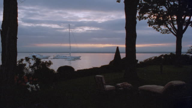 yachts and sailboats moor just off the north shore of long island. - golden hour stock videos & royalty-free footage