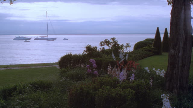 yachts and sailboats moor just off the north shore of long island. - 1995 stock videos & royalty-free footage