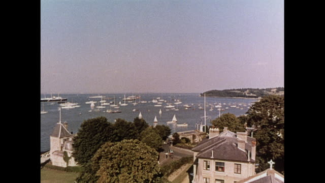 montage yachts and sailing ships at the marina in cowes / united kingdom - schiffsmast stock-videos und b-roll-filmmaterial