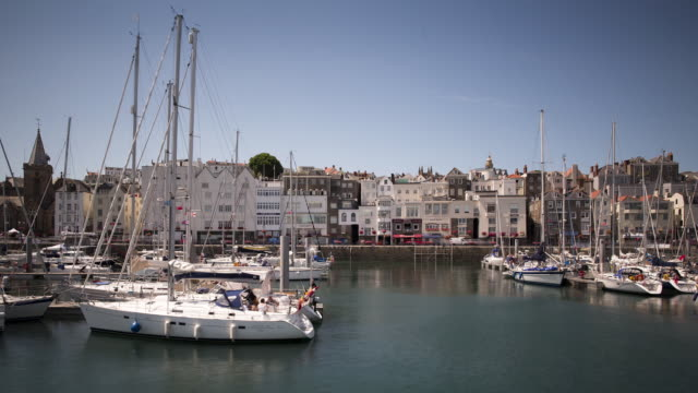 tl, ws yachts and traffic in the centre of st peter port / guernsey, united kingdom - channel islands england stock videos & royalty-free footage