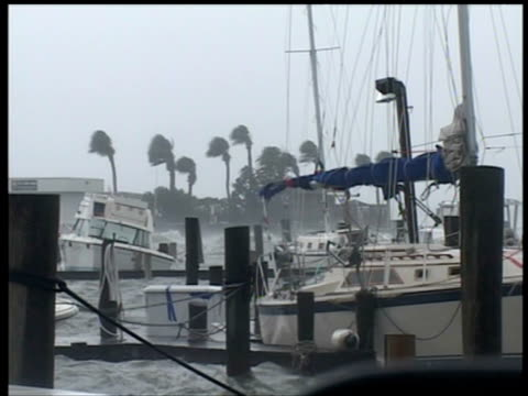 yachts are tossed about in fort pierce marina as hurricane frances stirs up big waves florida 4 sep 2004 - tauwerk stock-videos und b-roll-filmmaterial