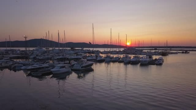 Yachts at marina on sunset,4k drone video