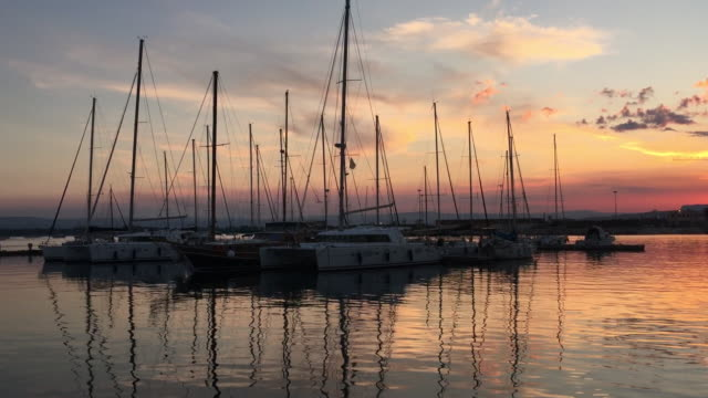 yachts at the port of syracuse, sicily at sunset. - sicily stock videos and b-roll footage