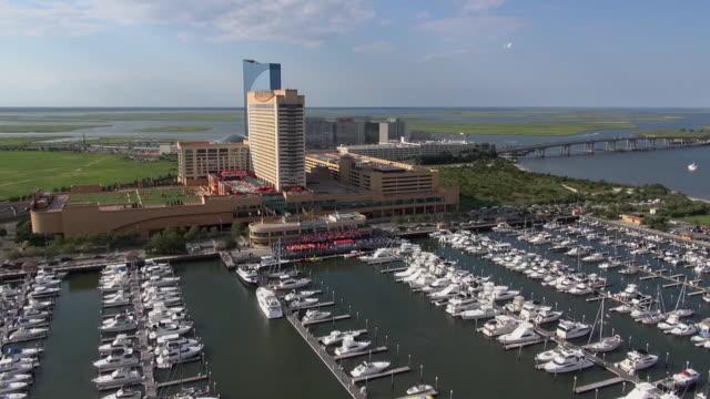 vídeos de stock, filmes e b-roll de yachts crowd a marina that borders casinos in atlantic city. - atlantic city