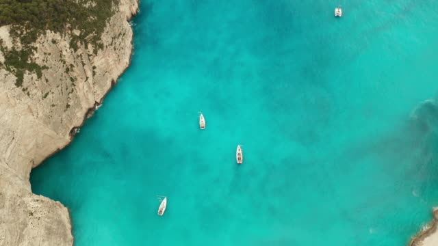 yachts in navagio bay and ship wreck beach in summer. zakynthos, greek island in the ionian sea - greece stock videos & royalty-free footage