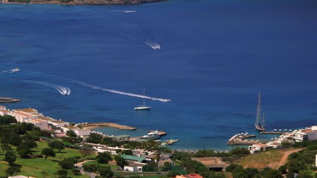 yachts & jet ski's in mirabello bay - 地中海点の映像素材/bロール