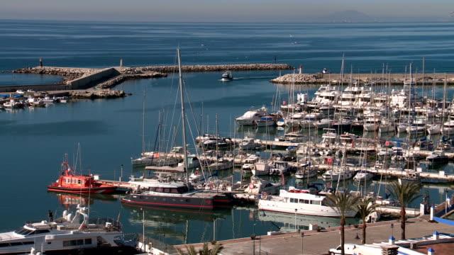 vídeos y material grabado en eventos de stock de yachts moored in estepona yacht & fishing port - imágenes
