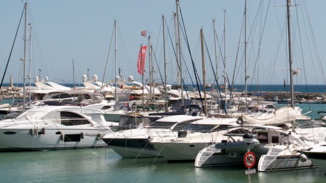 yachts moored in mediterranean marina, estepona - pier stock videos & royalty-free footage