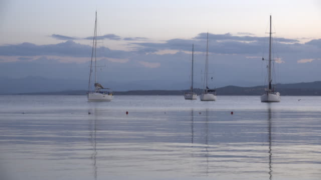yachts moored in the sea at dusk - sassari stock videos & royalty-free footage