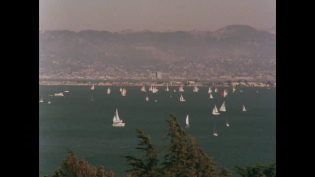 vídeos de stock e filmes b-roll de yachts on water sailing around san francisco bay - 1970 1979